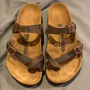 Birkenstock's, brown leather straps. Barely worn!